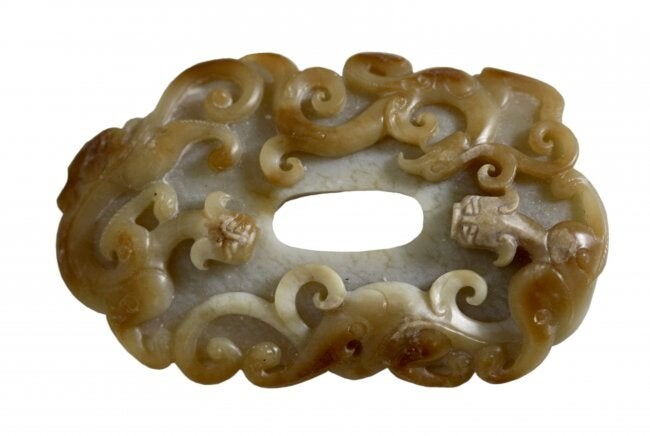 CHINESE ARCHAISTIC BEIGE AND RUSSET JADE CARVING