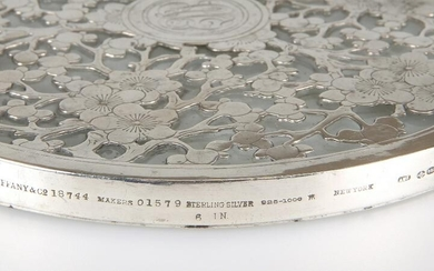 A LARGE TIFFANY & CO STERLING SILVER AND GLASS COASTER
