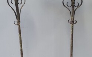 A PAIR OF ANTIQUE WROUGHT IRON CANDLESTANDS
