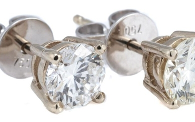 A PAIR OF SOLITAIRE DIAMOND STUD EARRINGS; each set in 18ct white gold with a round brilliant cut diamond, the 2 totalling approx. 1...