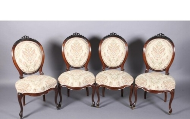 A SET OF FOUR VICTORIAN ROSEWOOD DINING CHAIRS, having an ov...