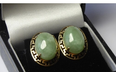 A VINTAGE PAIR OF YELLOW METAL AND JADE EARRINGS The oval ca...