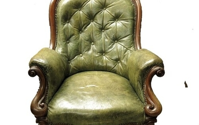 A Victorian carved mahogany and leather upholstered armchair...