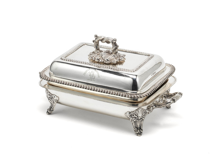 A Victorian silver entrée dish and cover with warming base