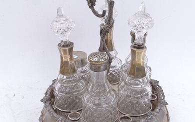 WITHDRAWN - A Victorian silver plated 6-bottle condiment sta...