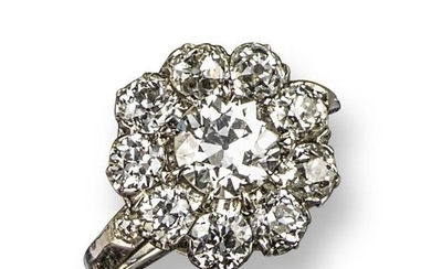 A diamond cluster ring, set with old circular-cut...