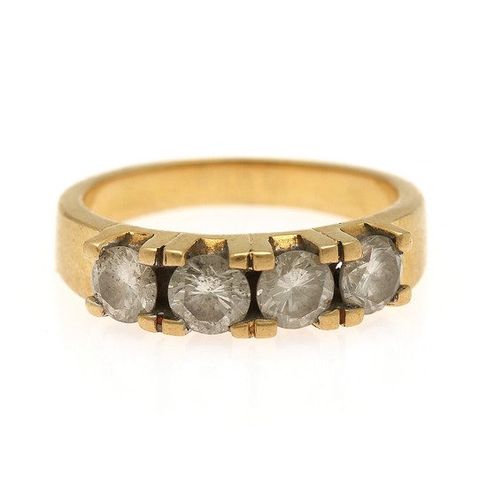 A diamond eternity ring set with four brilliant-cut diamonds, mounted in 18k gold. Size 55.