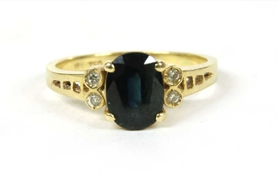 A gold sapphire and diamond ring