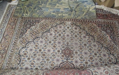 A large Indo-Persian carpet having multiguard borders and ge...