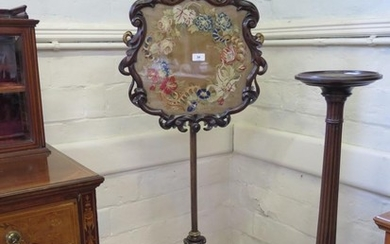 A mid Victorian rosewood pole screen, the foliate scroll scr...