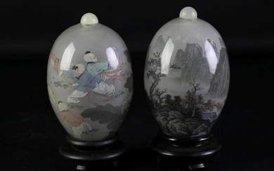 A pair of Chinese inside painted glass eggs, with original stands