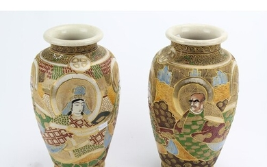 A pair of Japanese Kyoto ware vases, decorated with immortal...