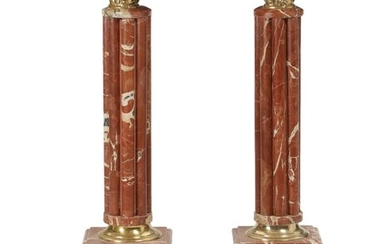 A pair of Louis XVI style reddish marble and bronze pedestals. 20th-21st century. H. 102. W. 26. D. 27 cm. (2)