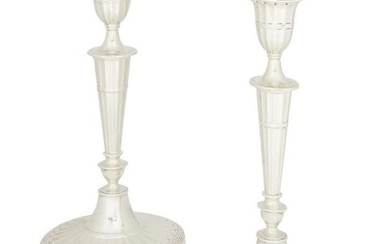 A pair of Victorian silver candlesticks, London,...