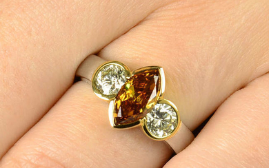 A platinum Fancy Deep Brownish Yellowish Orange diamond and diamond three-stone ring, by Hans D. Krieger.