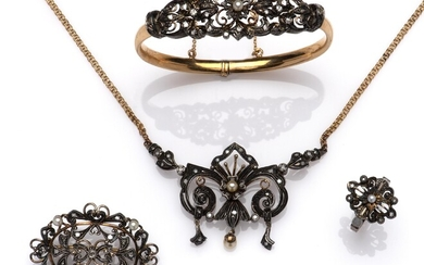 A suite of 18k gold and silver diamond jewels