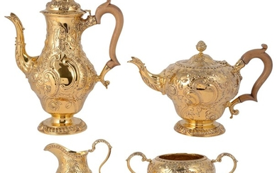 AN EDWARDIAN SILVER-GILT FOUR-PIECE TEA AND COFFEE SET, D. &...