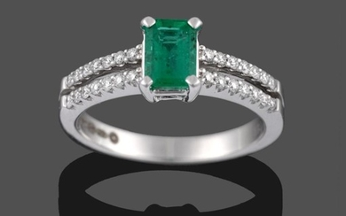 An 18 Carat White Gold Emerald and Diamond Ring, the...