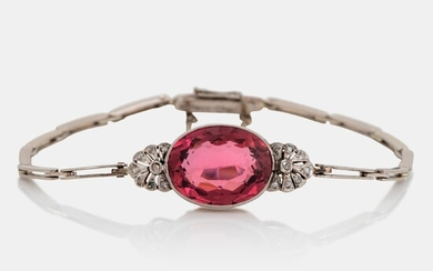 An 18K gold bracelet set with a faceted pink tourmaline weight ca 6.00 cts