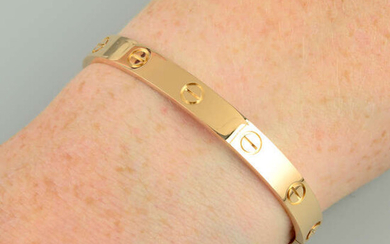 An 18ct gold 'Love' bangle, by Cartier.