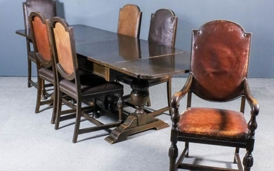 An Oak Draw Leaf Dining Table, 1920's/1930's, and a...