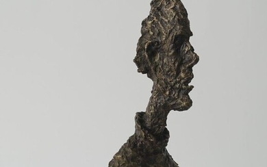 Bronze sculpture on stone base, Man's bust after Giacometti, 21st century, h. 40 cm.
