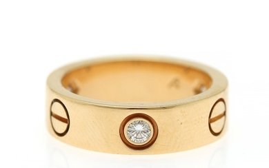 "Cartier: A ""Love"" diamond ring set with three brilliant-cut diamonds, mounted in 18k gold. W. 5.4 mm. Size 50."