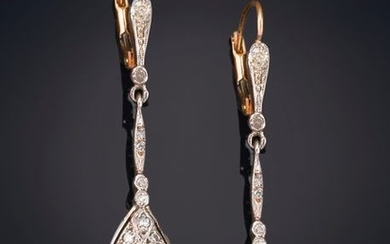 DIAMOND EARRINGS on a yellow gold frame with...