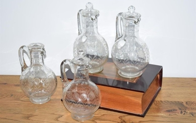 Four small engraved crystal decanters (one incomplete stopper)...