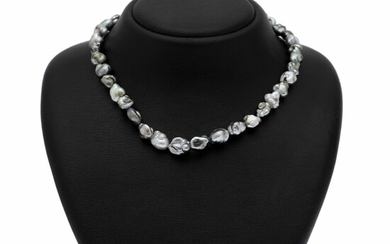 Hartmann's: A Keshi pearl necklace set with numerous cultured Keshi pearls and clasp of 14k white gold. Pearl diam. app. 9–11.2 mm. L. app. 44 cm.