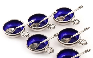 "Johan Rohde: ""Acorn"". A set of six sterling silver salt cellars, interior decorated with blue enamel, with belonging spoons. Georg Jensen, after 1945. (12)"