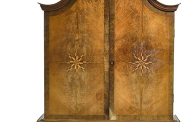 """Kaj Gottlob: Impressive and unique bar cabinet of nut wood and nut root, mounted on tall, carved """"spiral"""" base. Cabinet with curvy top, front with two doors."""