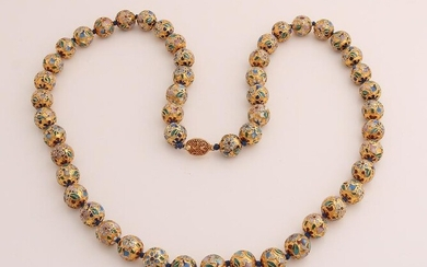 Necklace of gold colored beads, &#248 12mm, inlaid