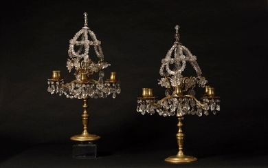 Pair of gilt bronze girandoles with six branches of light decorated in the upper part with lace crystals and rock crystal pendants. Style Louis XIV - XIXth century H : 55 cm diam : 38 cm The assembly of these girandoles is inspired by the models of...