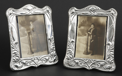 Pair of photo frames in marked solid silver...
