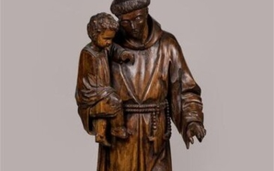 STATUE in natural wood carved in the round, decorated with a Saint Anthony of Padua in Franciscan dress, rosary tied at the waist, carrying the Child Jesus in his right hand. Late 18th - early 19th century. 120 x 46 x 39 cm. Missing and accidents.