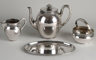 Silver tea service, 835/000, with pearl rim, consisting of a teapot, milk jug and sugar bowl with hinged handle. MT .: A. Presburg & Son, Haarlem. jl.:z:1959. The milk jug and sugar bowl are placed on a plated tray and fitted with a plated sugar scoop...