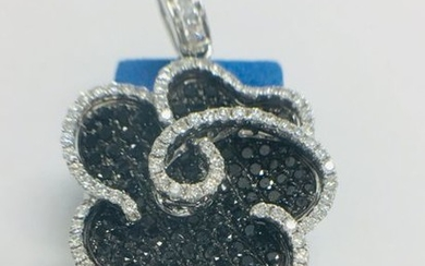 18ct white gold diamond pendant featuring 102 round...