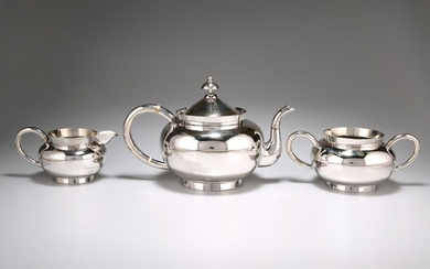 A CHINESE SILVER THREE PIECE TEA SERVICE, by Wang Hing