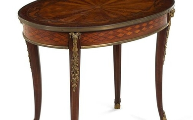 A Continental Marquetry and Gilt Metal Mounted Low