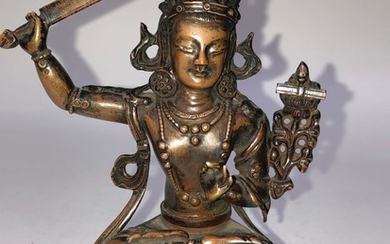 A Copper Alloy Figurine of Manjushri.