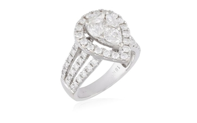 A DIAMOND DRESS RING, composed of a pear-shaped...