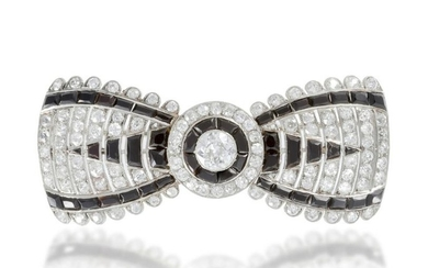 A French Cartier Art Deco diamond and onyx bow brooch