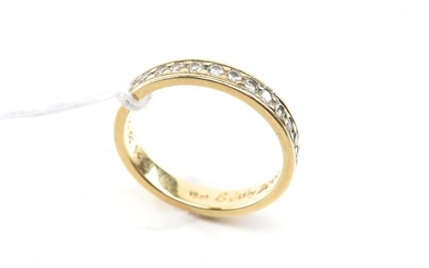 A HALF CIRCLE DIAMOND BAND IN 18CT GOLD, SIZE J