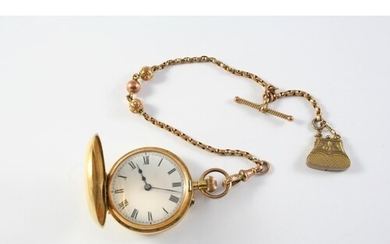 A LADY'S 18CT GOLD FOB WATCH the white enamel dial with Roma...