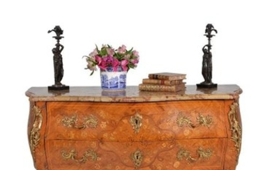 A Louis XV tulipwood and floral marquetry serpentine commode, circa 1760