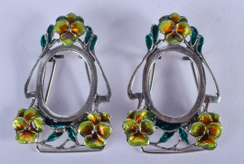 A PAIR OF MINIATURE SILVER AND ENAMEL FRAMES. 3.5 cm x