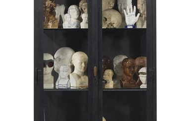 A PATINATED METAL AND GLASS VITRINE, WITH A GROUP OF 33 PHRENOLOGY HEADS AND IMPLEMENTS AND CRANIUM MODELS, THE CABINET MID-20TH CENTURY, THE OBJECTS LATE 19TH TO 21ST CENTURIES