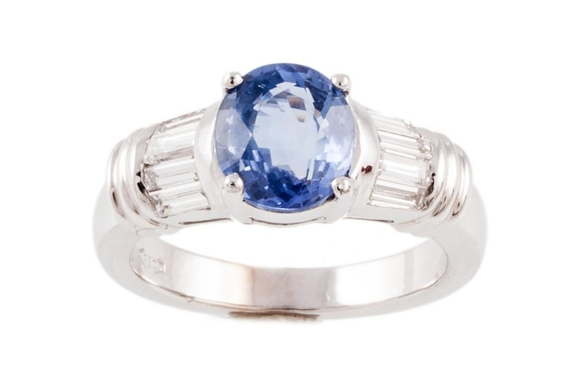 A SAPPHIRE AND DIAMOND RING, with one oval cut sapphire of 2...