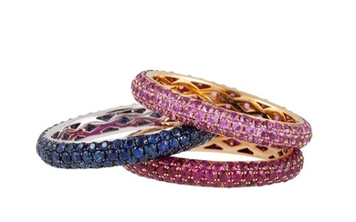 A SUITE OF THREE GEM SET ETERNITY RINGS, each pavé set with ...